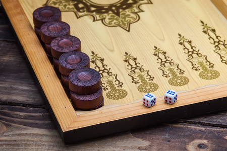 backgammon: The game backgammon on the wooden table
