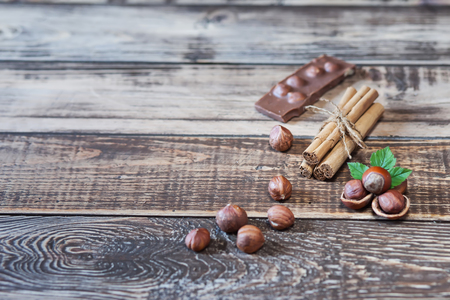 chocolate and different spices on wooden table