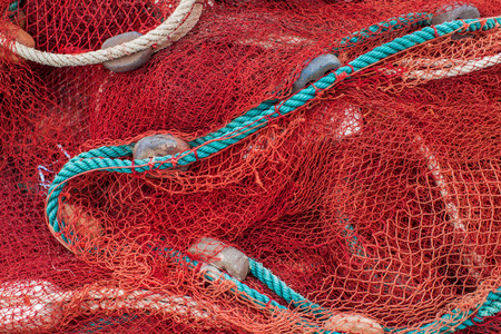 Close up view of fishing net marine background
