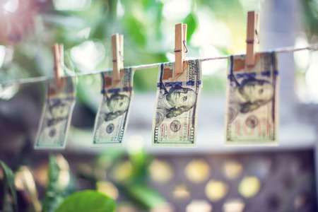 US dollar banknotes hanging on rope for money laundering conept