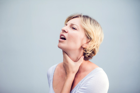 Throat Pain. Closeup Of Sick Woman With Sore Throat Feeling Bad, Suffering From Painful Swallowing. Beautiful Girl Touching Neck With Hand. Illness, Health Care And Medicine Concepts