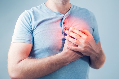 Adult male with heart attack or heart burn condition, health and medicine concept Stock Photo