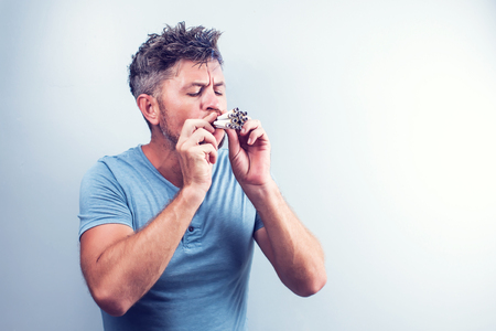 Young man with many cigarettes in his mouth 免版税图像