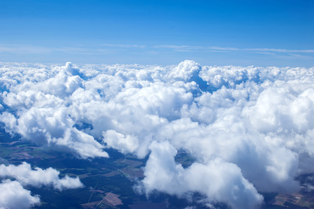 Beautiful view of cumulus clouds with sunny day atmosphere from airplain window Stock Photo