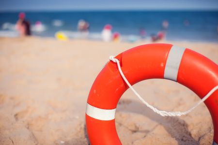Lifebuoy hangs on the beach for the safety of people on swimming on sea Standard-Bild