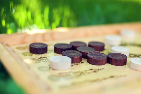 Color detail Backgammon game with two dice close up on the grass Stock Photo