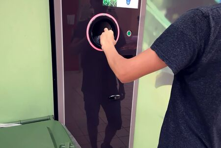 Shoppers return their bottles and cans of reusable packagings in a reverse vending machine