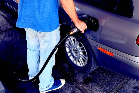 Man refuel his car's tank with gasoline. Transport concept