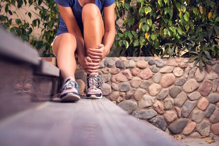 Woman feels strong foot pain. People, sport, healthcare and medicine concept