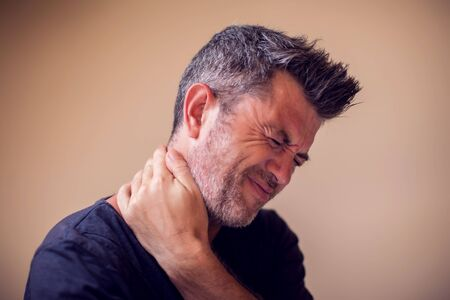 Man feels strong neck pain isolated. People, healthcare and medicine concept