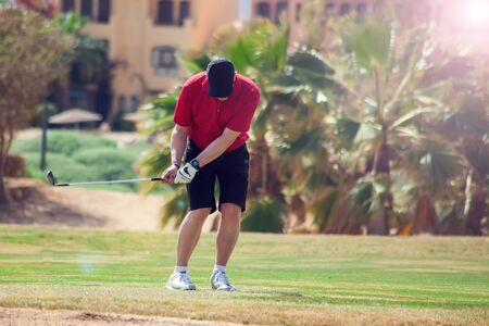 Man Playing Golf on Beautiful Sunny Green Golf Course. People, Sport and lifestyle concept