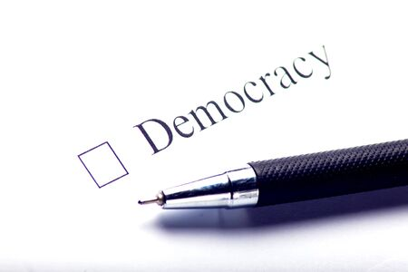 Democracy - checkbox with a cross on white paper. Checklist concept. Banco de Imagens