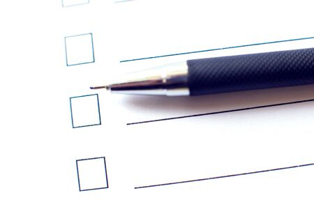 Checklist with a pen on white paper. Checkbox concept.