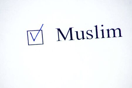 Checklist with a word Muslim on white paper with pen. Checkbox and religion concept.