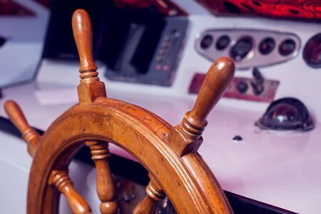 Wooden steering wheel and control panel on a yacht. Reklamní fotografie