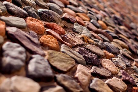 Pebble wall are made of stones of different sizes. Natural background Stock Photo