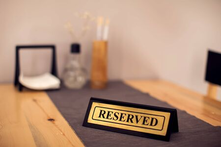 Reserved sign with capital letters on the dining table in restaurant Stok Fotoğraf