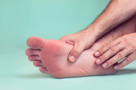 Man feels foot pain isolated. People, healthcare and medicine concept
