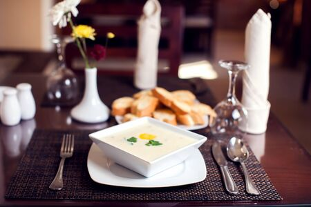 Cream soup and bread croutons on the table in cafe Stok Fotoğraf