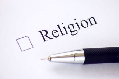 Checklist with a word Religion on white paper. Checkbox concept.