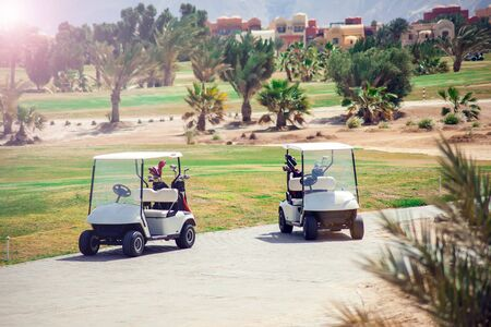 Golf carts on the grass sport field. Sport and lifestyle concept