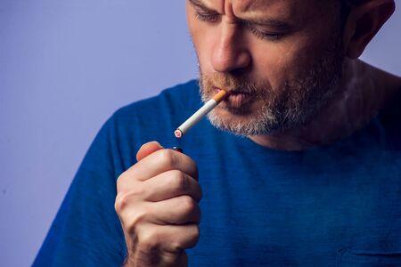 Close up of Man smoking cigarette. People, healt care concept