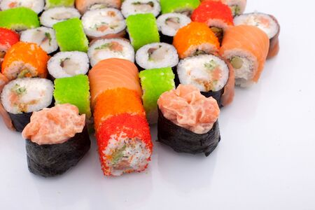 Big Mixed Set of Various Maki Sushi Isolated on White Background. Traditional Japaniese food Фото со стока