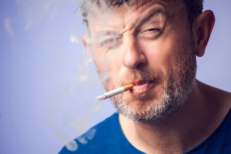 Close up of Man smoking cigarette. People, healt care concept Imagens - 131628967