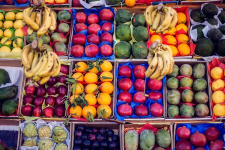 Colorful organic fruits in the marketplace. Bright summer background. Healthy food.