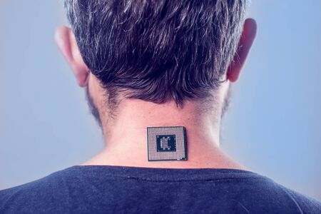 Bionic microchip (processor) implant in male human body - future technology and cybernetics concept