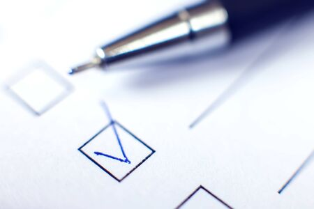 Checklist with a pen on white paper. Checkbox concept. Stock Photo