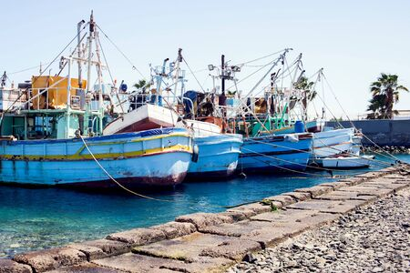 A lot of blue fising boats in the port in Egypt.