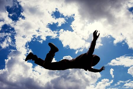 A silhouette of man flying in the sky. Afterlife, mystery and dream concept 版權商用圖片