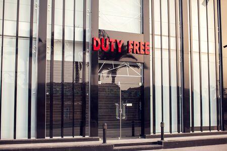 En entrance of duty free shop in the city outside