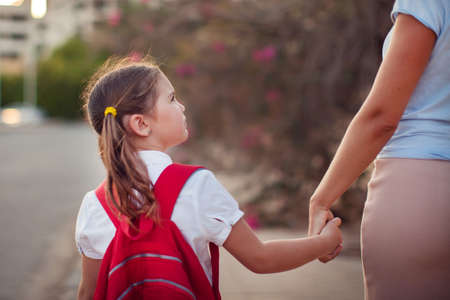 Back to school. Parent care concept. Pupil and mother going to school.