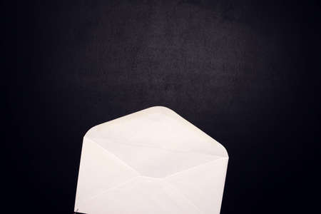 Open envelope on the black background. Information and business concept Stock fotó