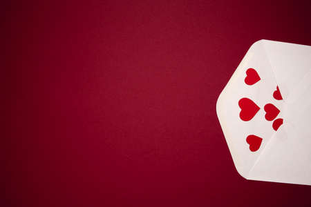 Envelope with hearts on red background. Romance and love concept Stock fotó - 163816949