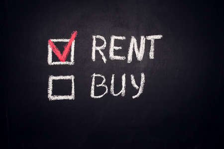Rent and Buy checkbox on blackboard. Choice and real estate concept Stock fotó