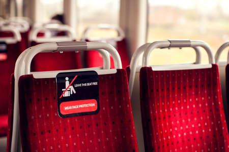 Social distance sign in train during the coronavirus pandemic. Empty seats in public transport with new social distancing protect rules during pandemic of coronavirus