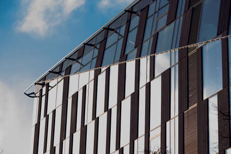 Mirrored facade building. Modern office against blue sky. Architecture concept