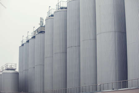 Contemporary large steel barrels in winery. Vine industry