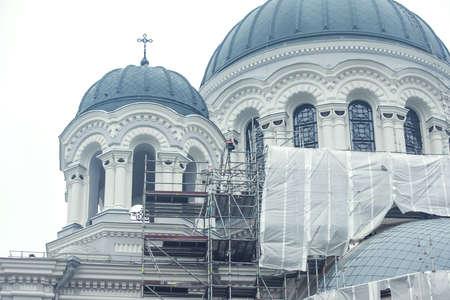 Cathedral reconstruction in Kaunas city, scaffolding construction. Building facade renovation. Stock fotó