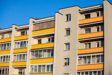 Exterior of apartment building on a blue sky background. No people. Real estate business concept. Stock fotó - 163817357