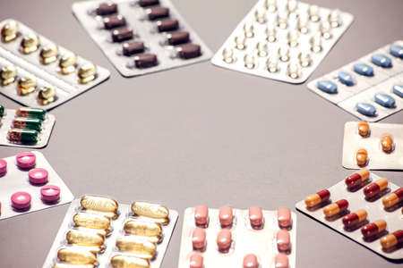 Capsules pill in blister packaging. Pharmaceutical industry concept. Pharmacy drugstore. Antibiotic drug resistance. Medicine and health care concept