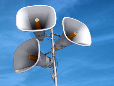A few megaphones on a pole with a blue sky background. Imagens