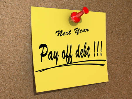 A note pinned to a cork board with the text Pay off debt  Stock Photo