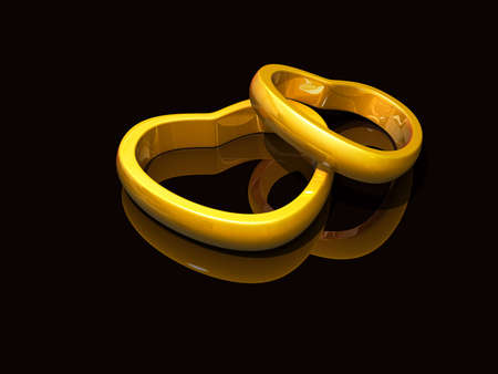 Valentines Gold Heart rings on a shiny dark background Stock Photo - 16822565