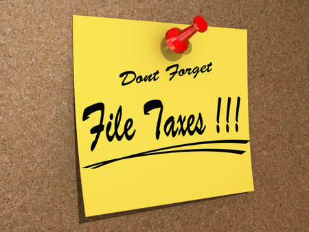 A note pinned to a cork board with the text File Taxes. Stock Photo