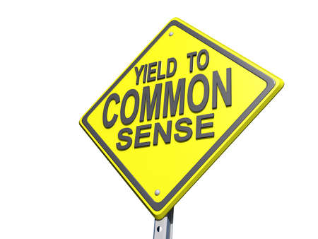 common sense: A yield road sign with  Stock Photo