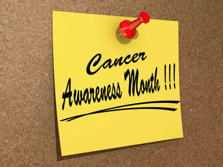 A note pinned to a cork board with the text Cancer Awareness Month